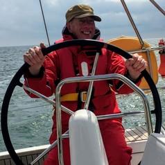 Dr. Peter Jones steering a ship
